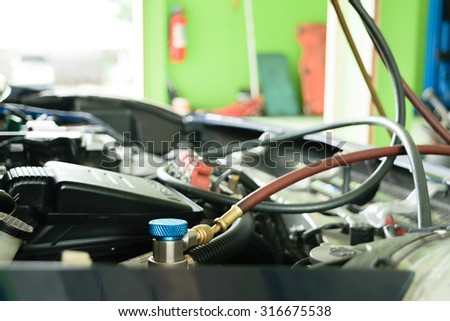 Car refilling air condition in air shop - stock photo