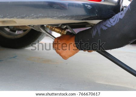 Car refuel LPG or liquefied petroleum gas at gas station.