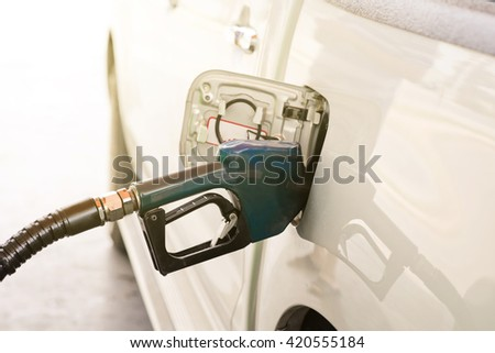 Car refueling on a petrol station. - stock photo