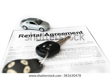 Car rental agreement with car on center. Auto rental agreement or legal document - stock photo