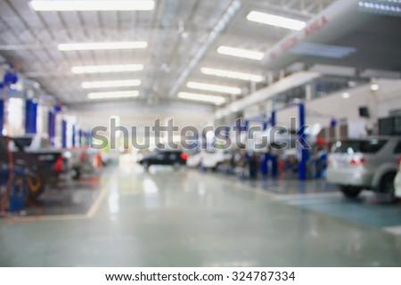 car repair maintenance service center blurred background - stock photo
