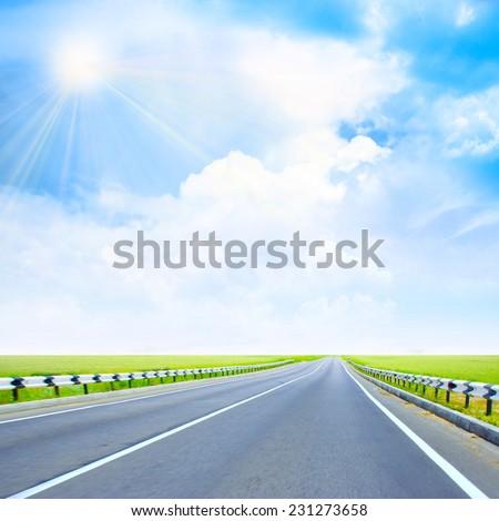 car road under beautiful solar sky - stock photo