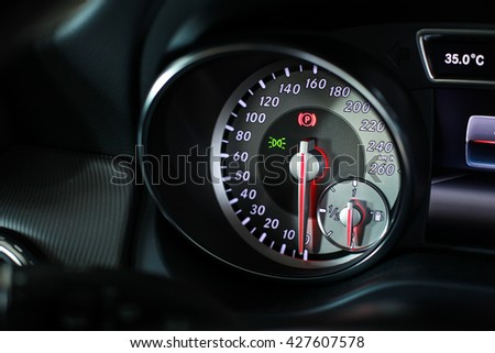 Car's Dashboard including gauges and meter - stock photo
