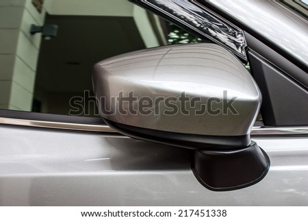 car's side mirror - stock photo