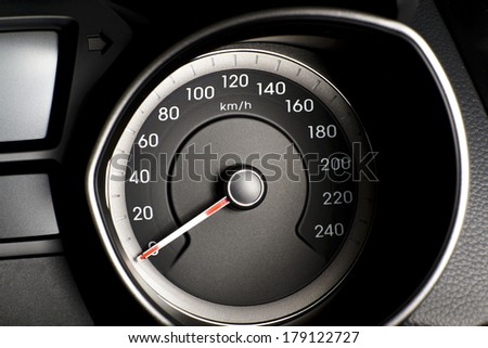 Car's, vehicle's speedometer or tachometer with visible information display - ignition warning lamp  and brake system warning lamp, visible symbols of instrument cluster ( ten check warning light).