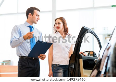 car salesman declares a young girl advantages of the new car