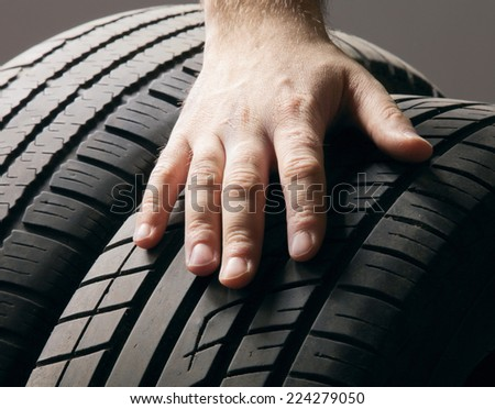 Car service.A  wheel from a car - stock photo