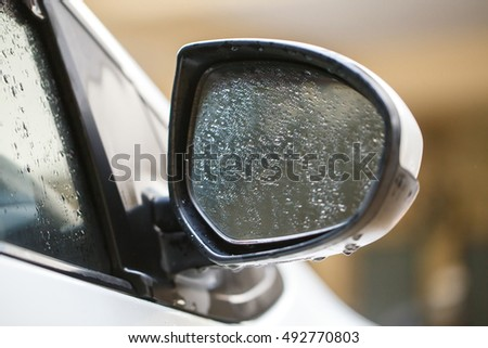 car side mirror on raining day.