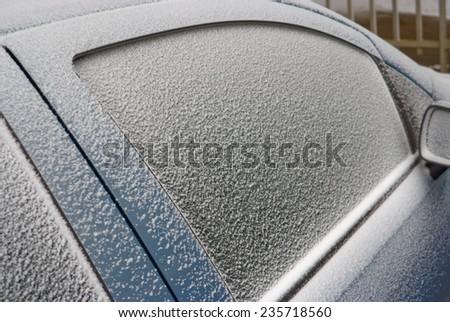car sidewindows and rearview mirror, snowbound - stock photo