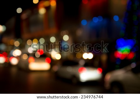 car sparkle light on road when christmas day (Blurred Style) - stock photo