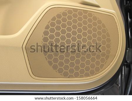 Car speaker on door panel - stock photo