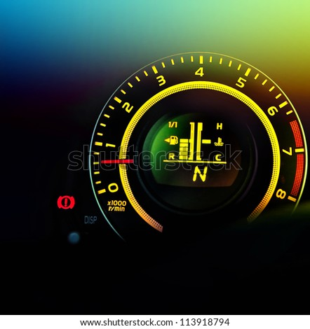 car speedometer and fuel gauge - stock photo