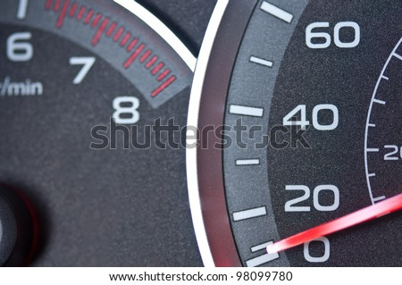 Car speedometer and tachometer - stock photo