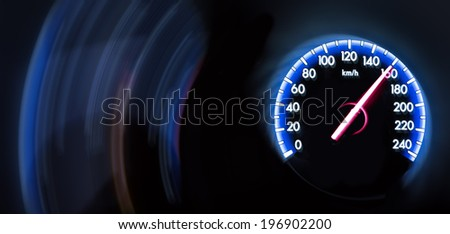 Car Speedometer on dark background