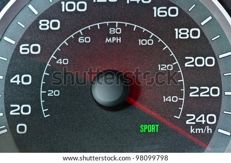 Car speedometer with blurred needle - stock photo