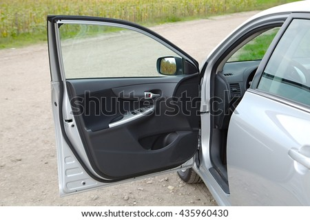 Car stopped with open door - stock photo