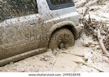Car stuck in mud - stock photo