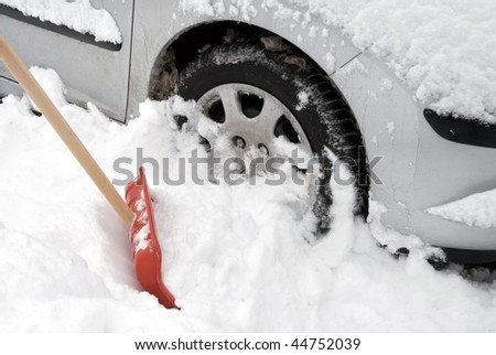 Car stuck in snow - stock photo