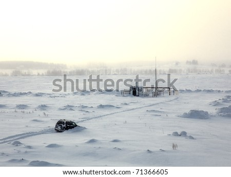 car stuck in snow near the research station - stock photo