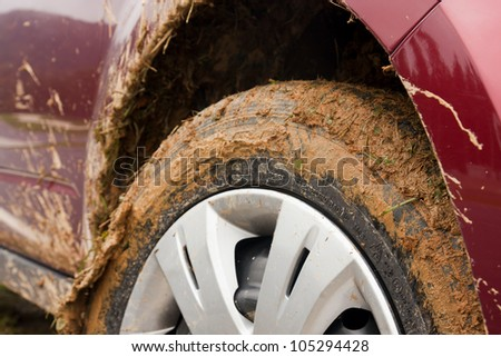 Car stuck in the mud - stock photo