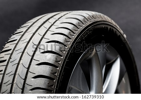 Car summer tires wheel worn profile structure on black background - stock photo
