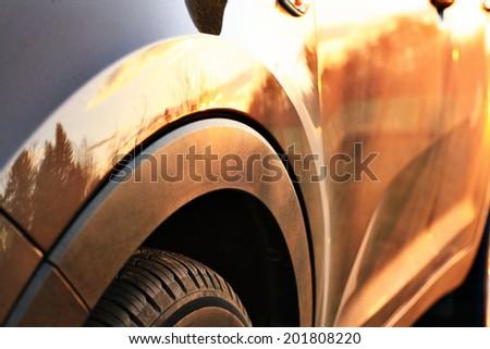 car sunset reflection - stock photo