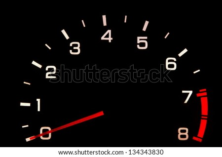 car tachometer closeup in the darkness - stock photo