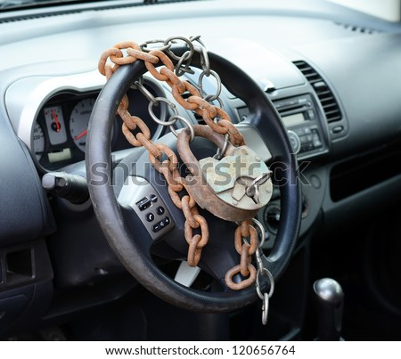 Car-theft protection - mechanical locking device, a concept - stock photo