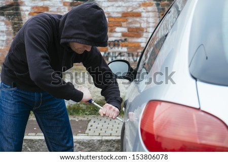 car thief in action