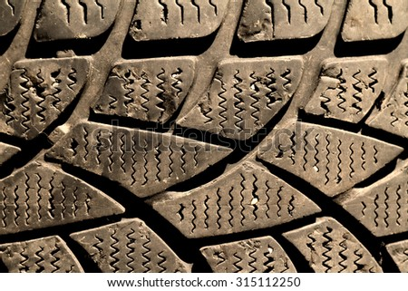 Car tire - close up photo - tire background - stock photo