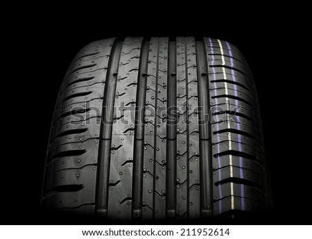 Car Tire isolated on black - stock photo