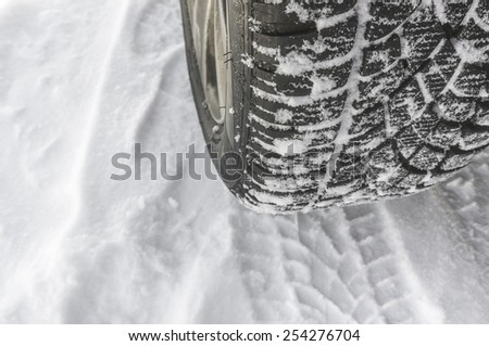 Car tire on a snow - stock photo