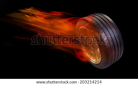 Car tire on fire. - stock photo