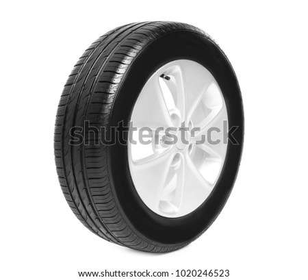 Car tire on white background