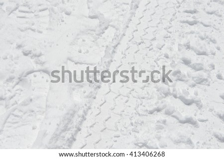 Car tire track in snow - stock photo