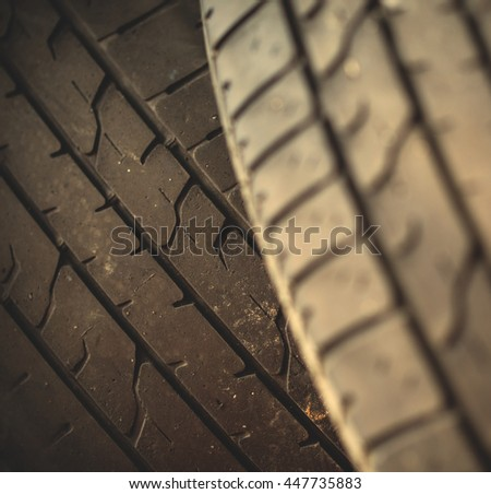 car tire wheel background. car wheel protector. shallow depth of field. instagram image filter retro style