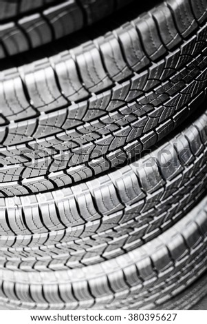 Car tires in a stack at an automotive repair service shop