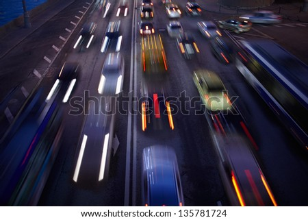 Car traffic at night. Motion blurred background. Long exposure shot. - stock photo