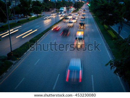 Car traffic at night. Motion blurred blur - stock photo