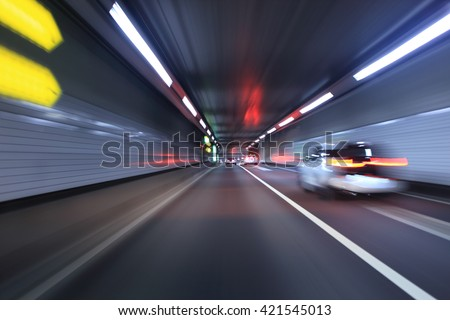 Car traffic in a tunnel , Tokyo highway