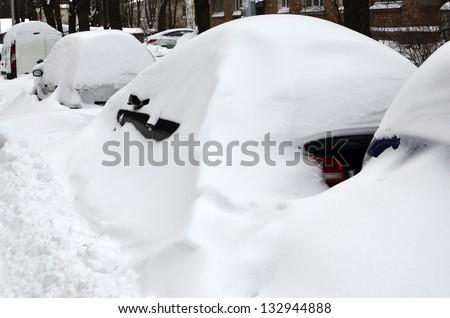 Car under snowdrift - stock photo