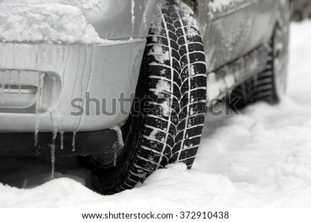 Car under the snow in the winter season. - stock photo