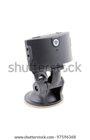 car video recorder in black on the suction cup to the glass - stock photo