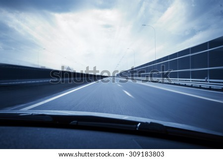 Car view with motion blur road background
