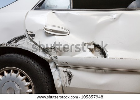 Car was crunched during an accident. Six month old child was behind door and survived with only minor scratches. Between the door and the car seat it protected the child from further harm - stock photo