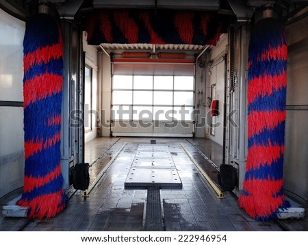 Car wash station. Automatic mechanized washing facility. Empty, no car inside, idle. Location: Europe. - stock photo