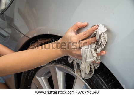 Car wash,Wipe car,Car Cleaning.Focus on hand.