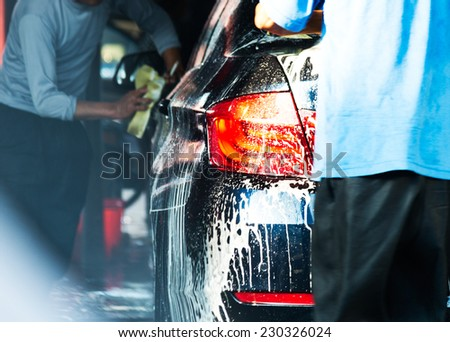 Car wash with flowing water and foam. - stock photo