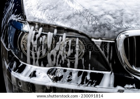 Car wash with soap. - stock photo