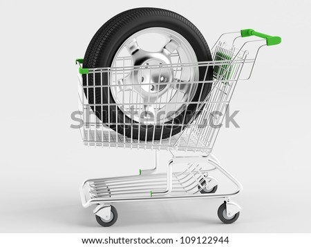 Car wheel drive in shopping cart - stock photo